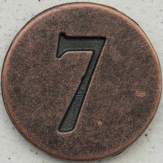 Number 7 stamped in copper circle